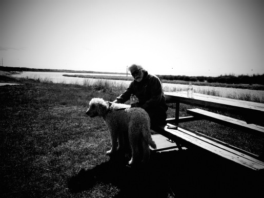 Man and Dog bond on the banks of the Sturgeon River